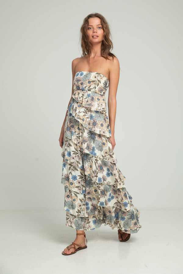 A woman wearing maxi floral strapless dress by Lilya