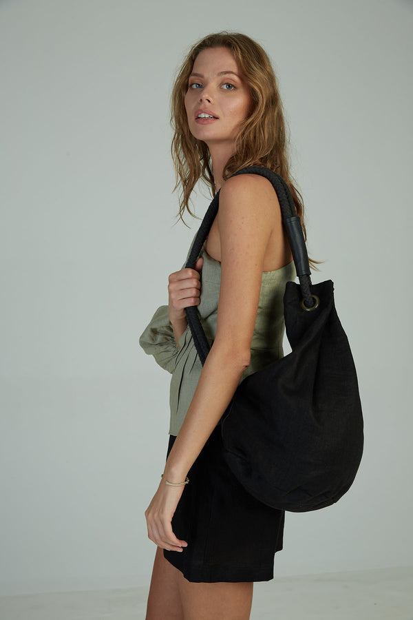 A woman wearing a casual linen rope bag by Lilya in Australia