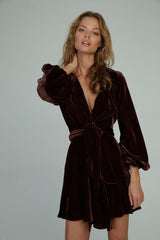 A woman wearing the chiara velvet mini wrap dress by Lilya