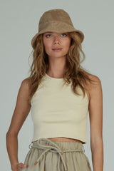 A woman in a ribbed crop tank by Lilya