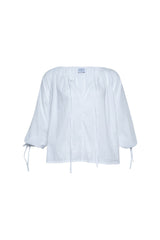 A white cotton top by Lilya