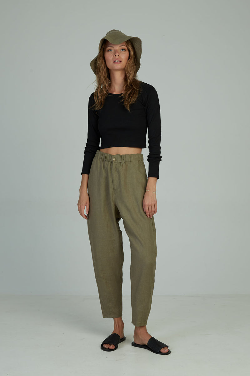 A woman in classic linen pants for Autumn by Lilya