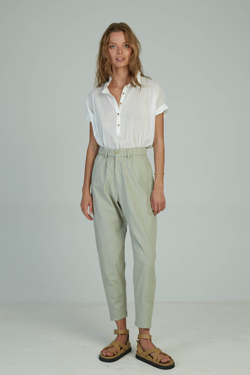 A woman in ankle length cotton pants by Lilya for summer