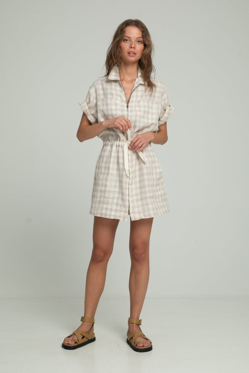 A woman in a linen check dress for summer by Lilya