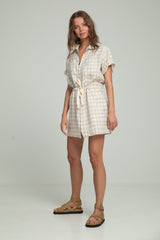 A woman in a linen check dress in beige by Lilya