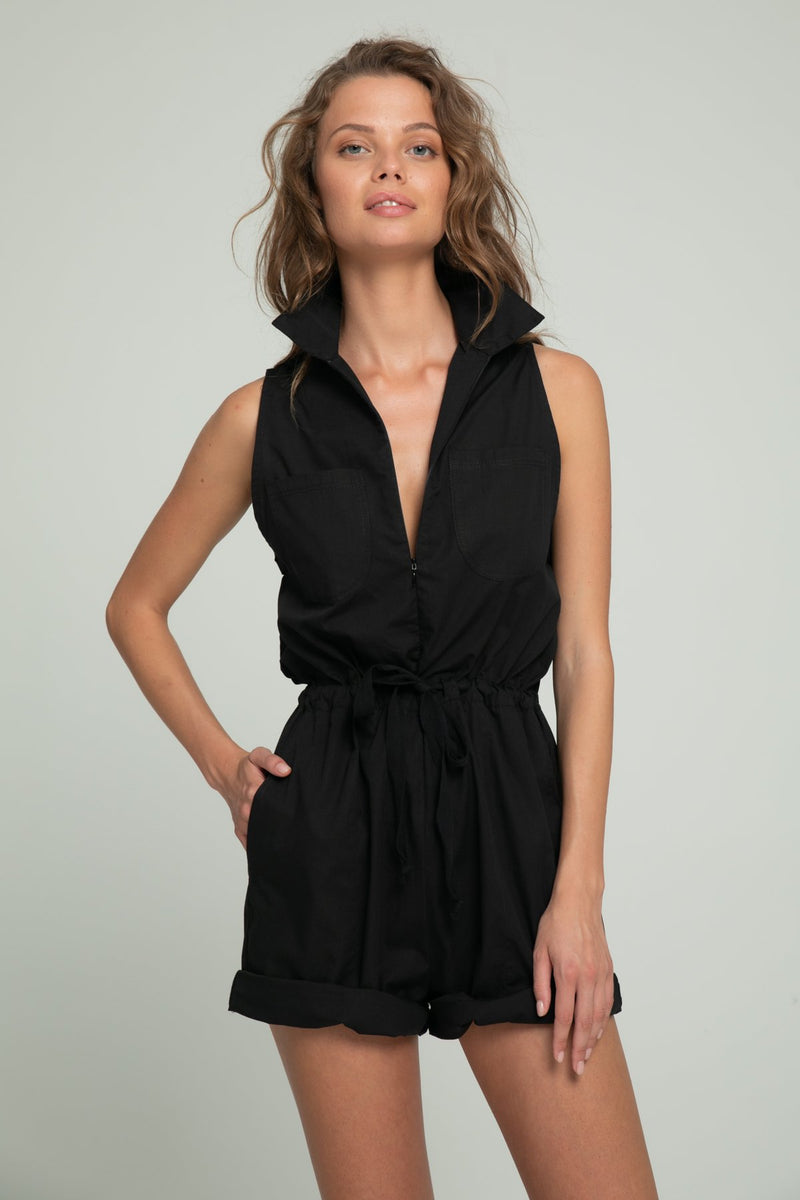 A woman wearing a black playsuit for summer by Lilya