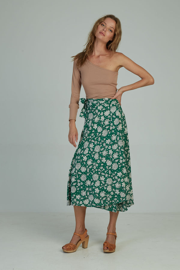 A woman in a floral wrap skirt by Lilya in Australia