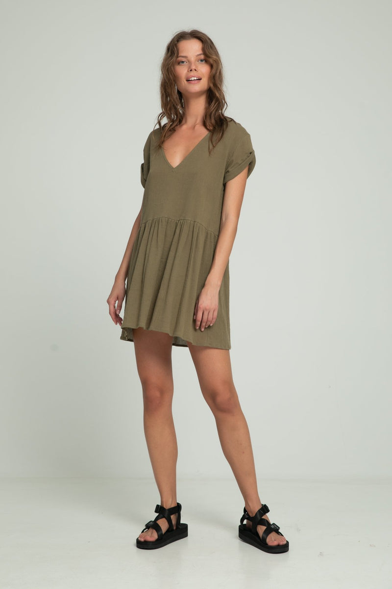 A woman in a short sleeve khaki dress for summer by Lilya