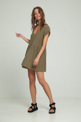 A woman in a mini khaki dress from cotton by Lilya