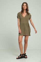 A woman wearing mini khaki dress for summer by Lilya