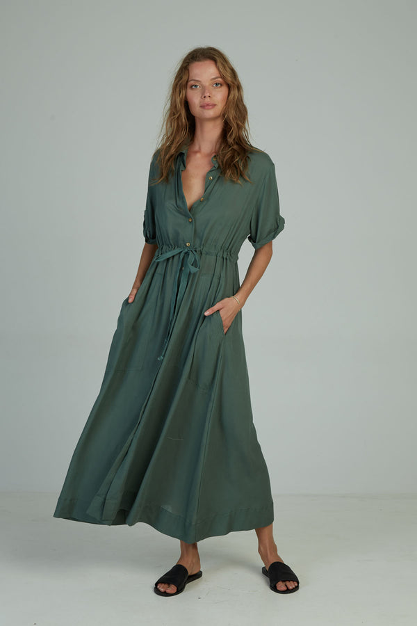 A woman in a maxi shirt dress by Lilya for autumn