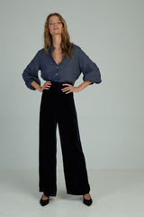 A woman wearing 70's flared velvet pants for winter by Lilya