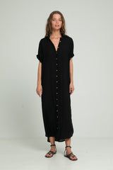 A woman in a classic button down black shirt dress by Australian Designer Lilya