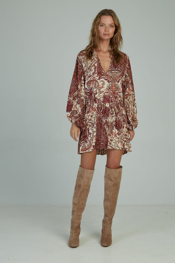 A woman in a casual paisley mini dress for winter by Lilya