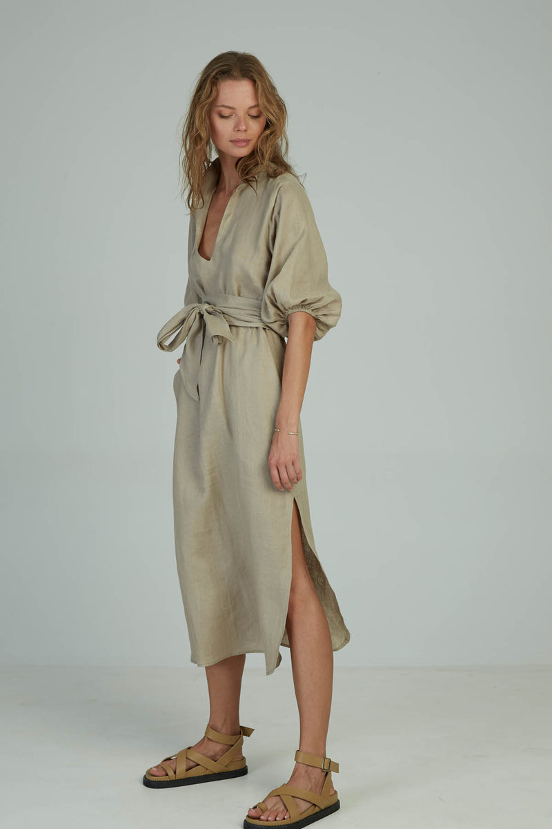 A woman in a kaftan maxi linen dress by Lilya