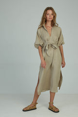 A woman wearing a linen kaftan style maxi dress with matching belt by Lilya