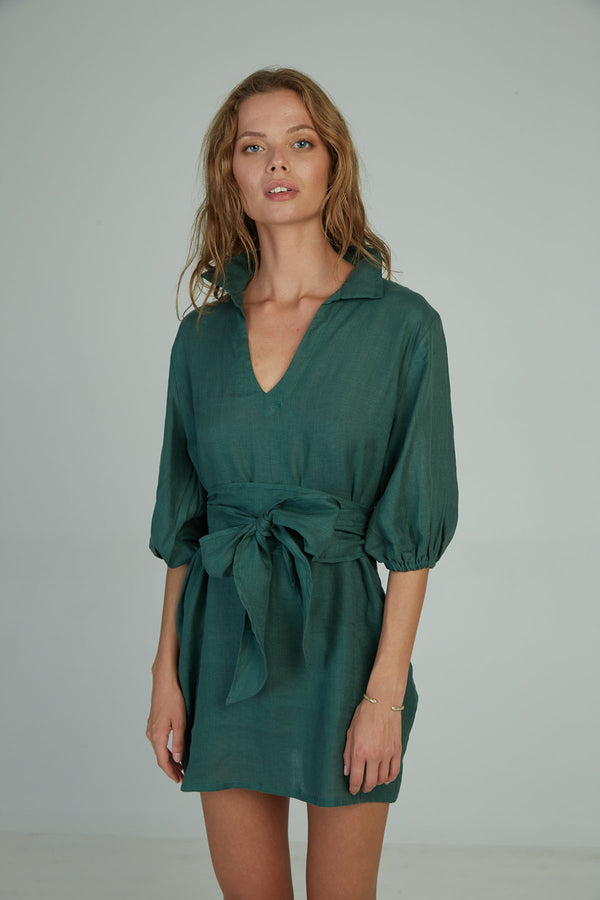 A woman in a rich green mini dress by Lilya in Australia