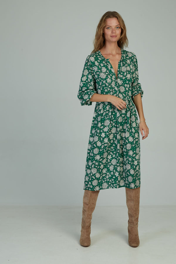 A woman in a casual midi floral dress by Lilya in Australia