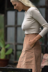 A woman in a long sleeve crop tank top by Lilya for winter