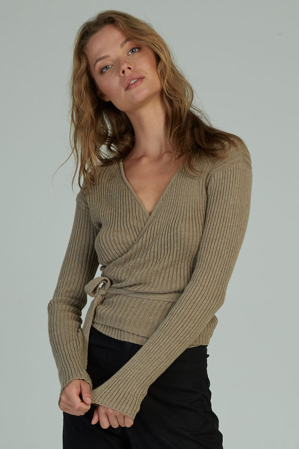 A woman in a long sleeve wrap ribbed top by Lilya