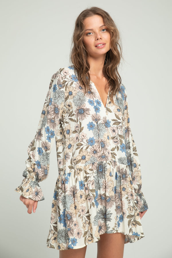 A woman wearing casual floral dress by Lilya