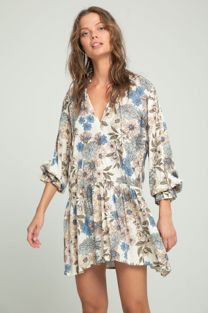 A woman wearing long sleeve floral dress by Lilya