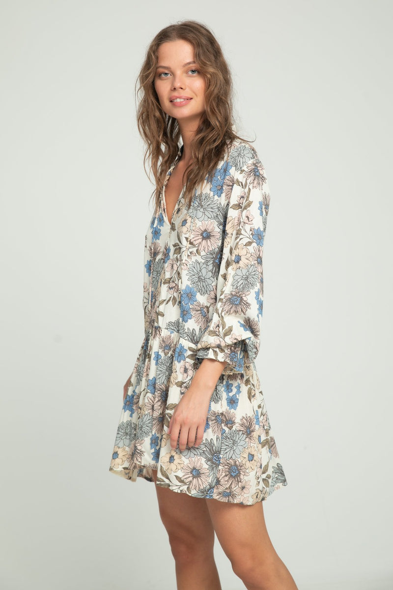 A woman wearing floral long sleeve dress by Lilya