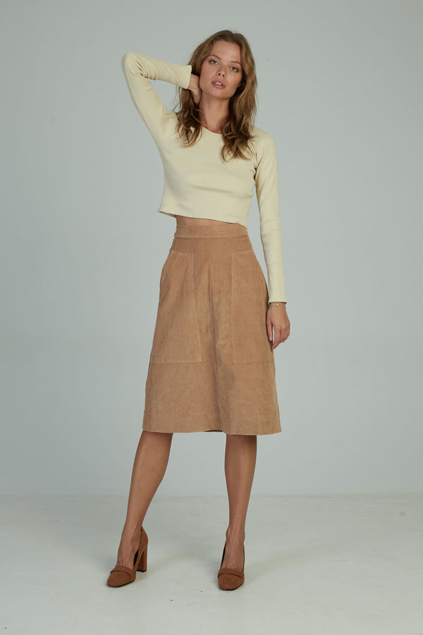 A woman in a midi cord A line skirt by Lilya