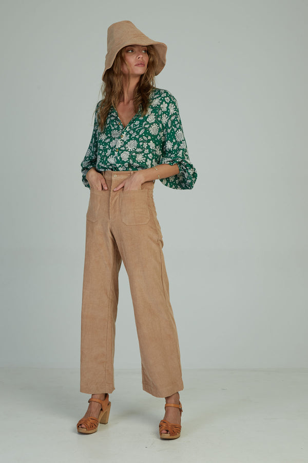 A woman in high waist pant by Lilya in Australia
