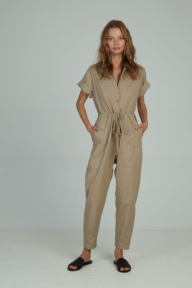 A woman in a short sleeve cotton jumpsuit by Lilya in Australia
