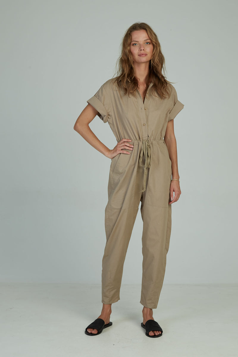 A woman in a casual utilitarian jumpsuit by Lilya
