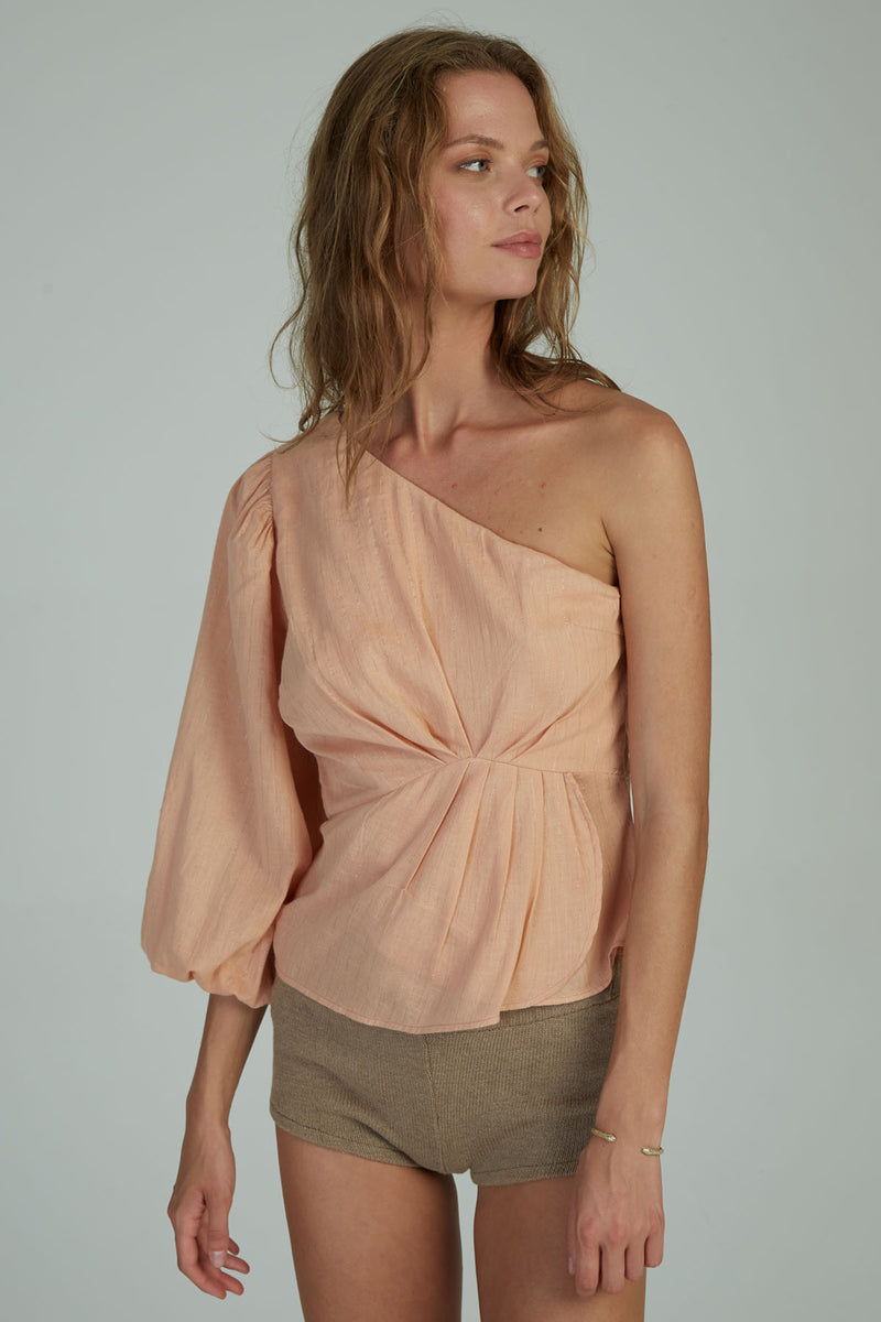 A woman in a one shoulder top for evenings by Lilya