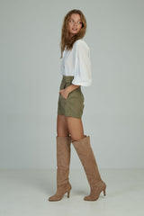 A woman in over the knee suede boots by Lilya