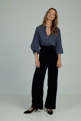 A woman wearing high waisted velvet pants by Lilya in Australia