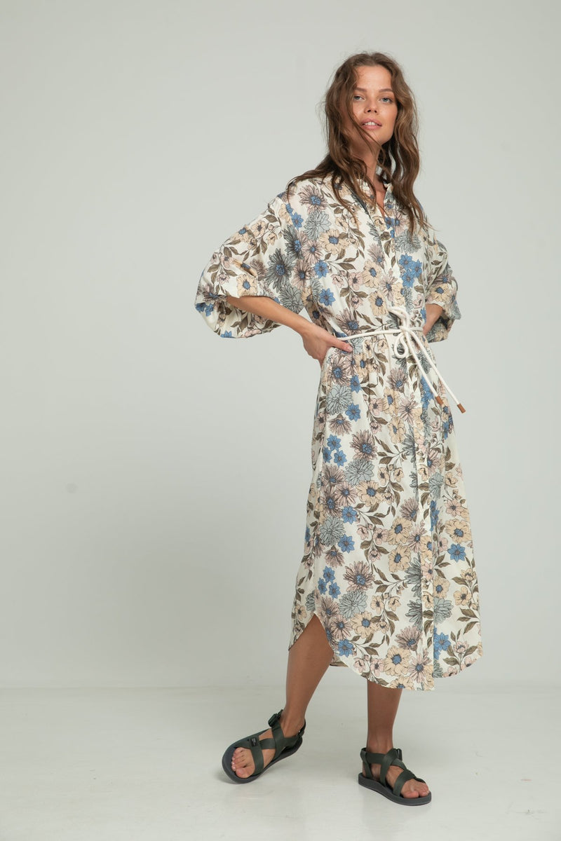 A woman wearing maxi dress with floral print by Lilya