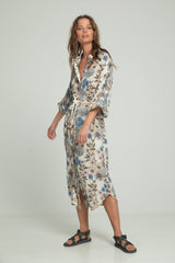 A woman wearing floral shirt dress by Lilya