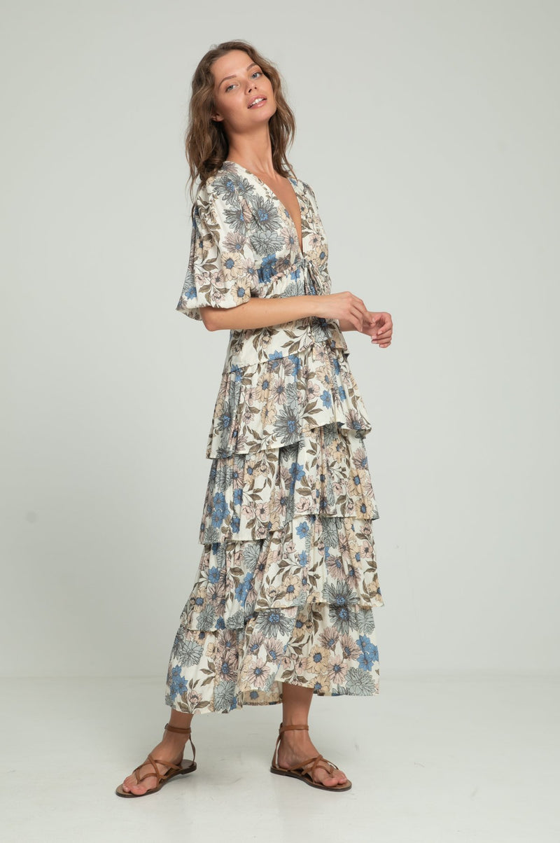 A woman wearing maxi floral dress with a frill layered skirt by Lilya