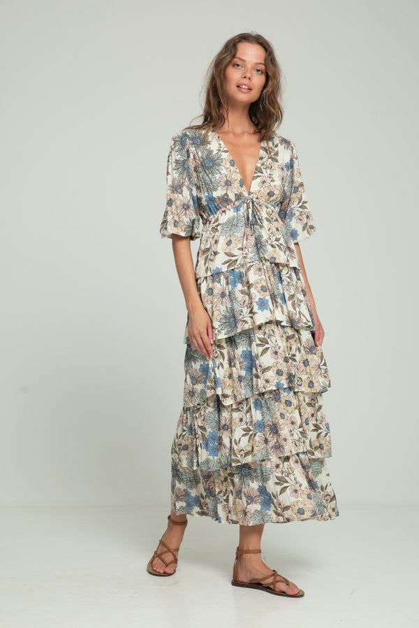 A woman wearing maxi floral dress for summer by Lilya