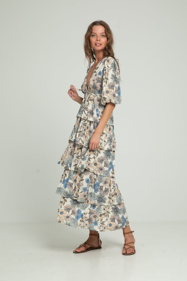 A woman wearing summer floral dress by Lilya