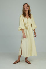 A woman in a linen maxi dress made by Lilya in Australia