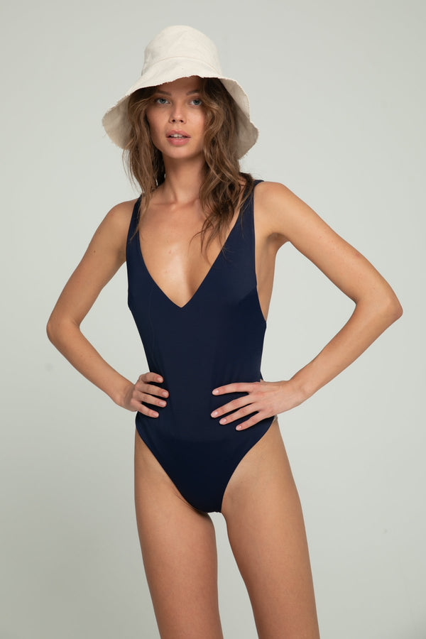 A woman in a navy bodysuit for summer by Lilya