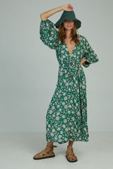 A woman in a long sleeve floral maxi dress by Lilya in Australia