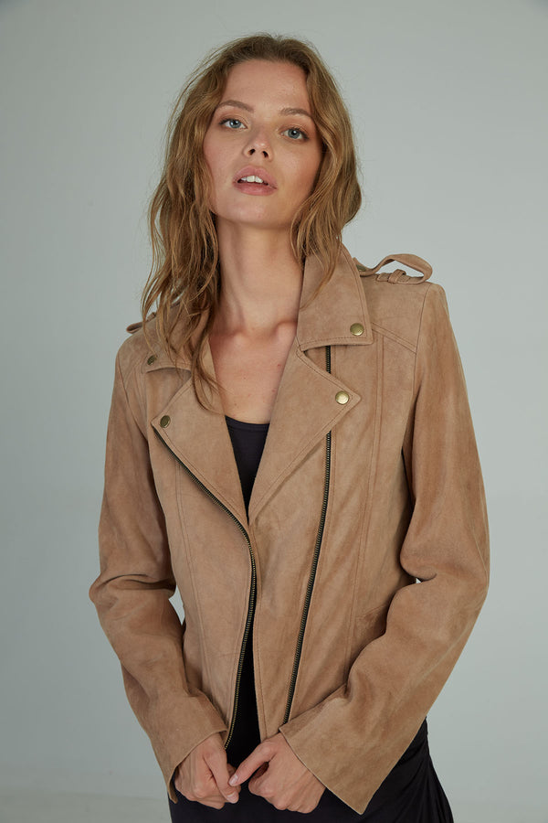 A woman in a soft suede winter jacket by Lilya