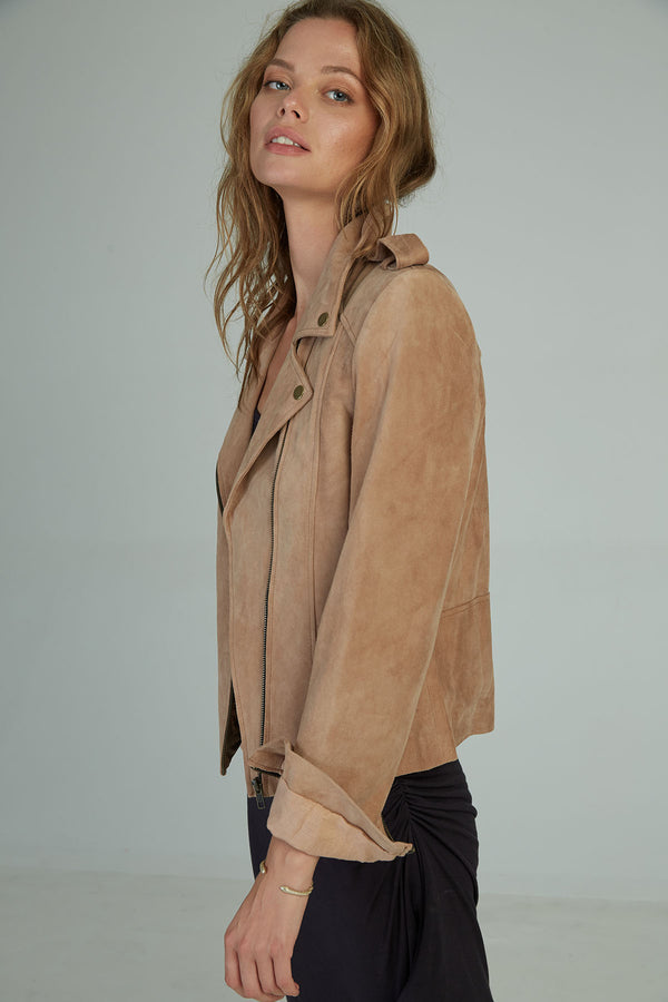 A woman in a suede leather jacket by Lilya in Australia