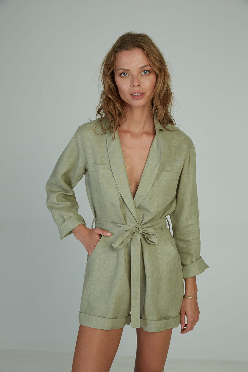 A woman in a long sleeve linen playsuit by Lilya