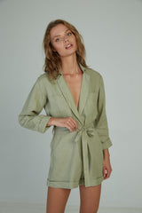 A woman in a linen playsuit for autumn by Lilya