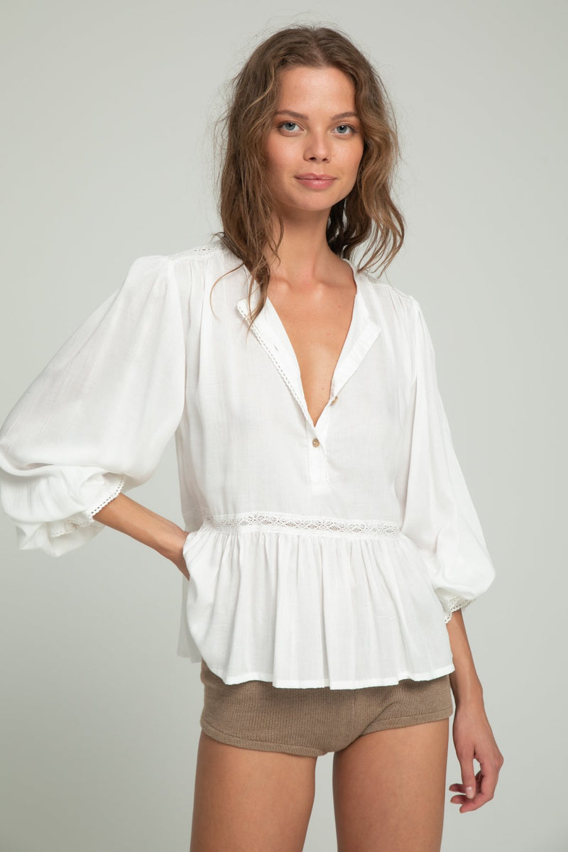 A woman in a ivory boho blouse by Lilya