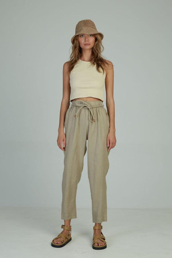 A woman in summer linen pants made by Lilya in Australia