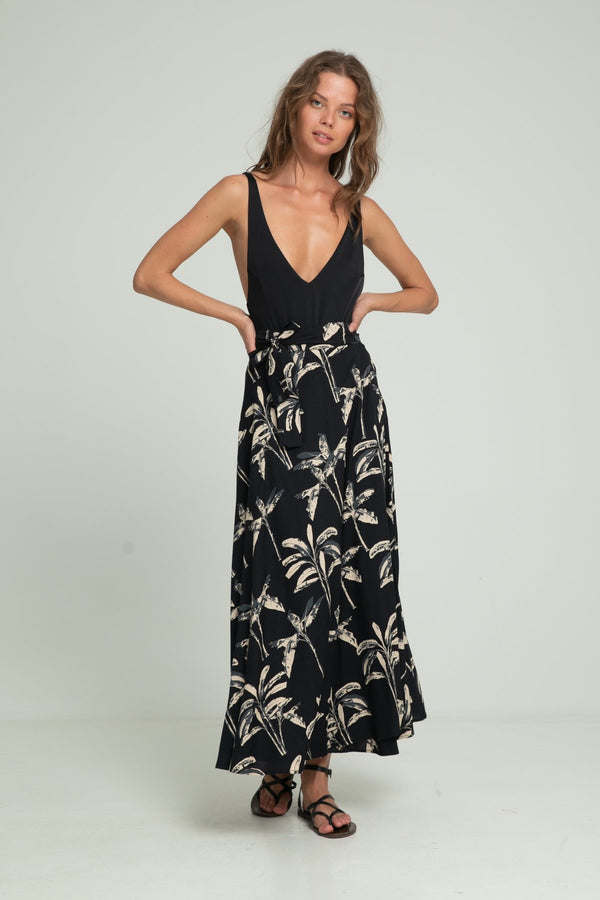 A woman wearing a leaf print wrap skirt by Lilya