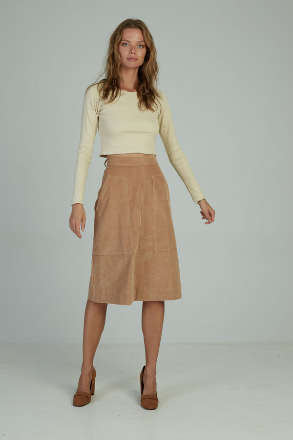 A woman in a corduroy midi skirt by Lilya in Australia